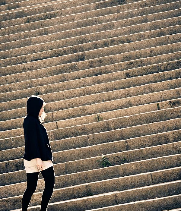 girl-in-black-on-stairs