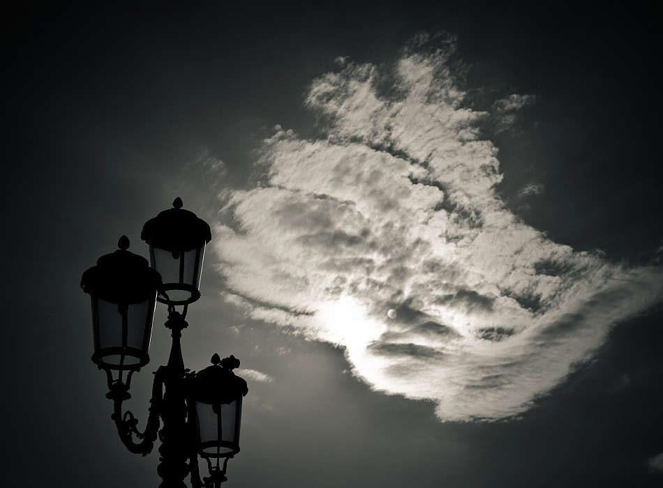street lamp with cloud and sun